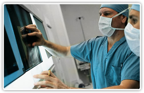 Dr. Zehr examining X-rays