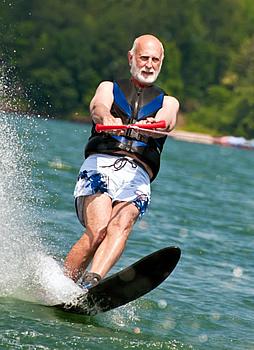 Man slalom waterskiing