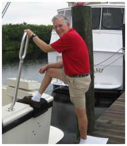 Joseph hart boarding his boat after hip replacement surgery by Dr. Robert Zehr