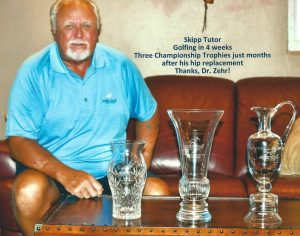Skipp Tutor shows off golfing trophies won after hip replacement surgery by Dr. Robert Zehr
