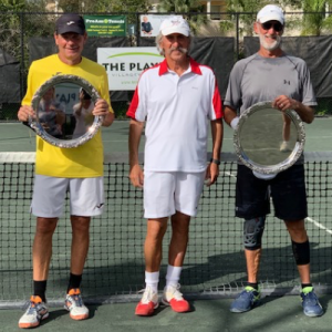 Dan Ellabarger, far left, with tennis trophy won after hip replacement surgery by Dr. Robert Zehr