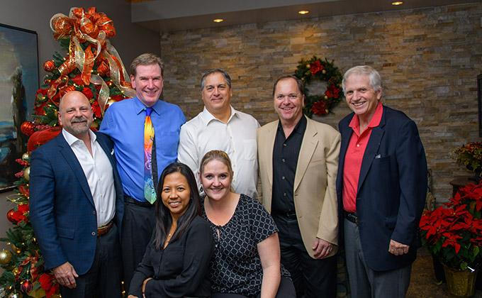 Dr. Robert Zehr with members of the Landmark Hospitals team.
