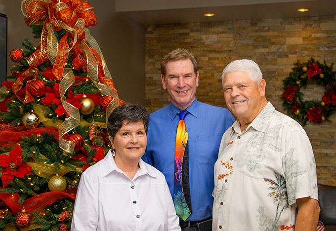 Dr. Robert Zehr with ZCO patient Mary Hart and Mary's husband Jim, former St. Louis (now Arizona) Cardinals quarterback Jim Hart